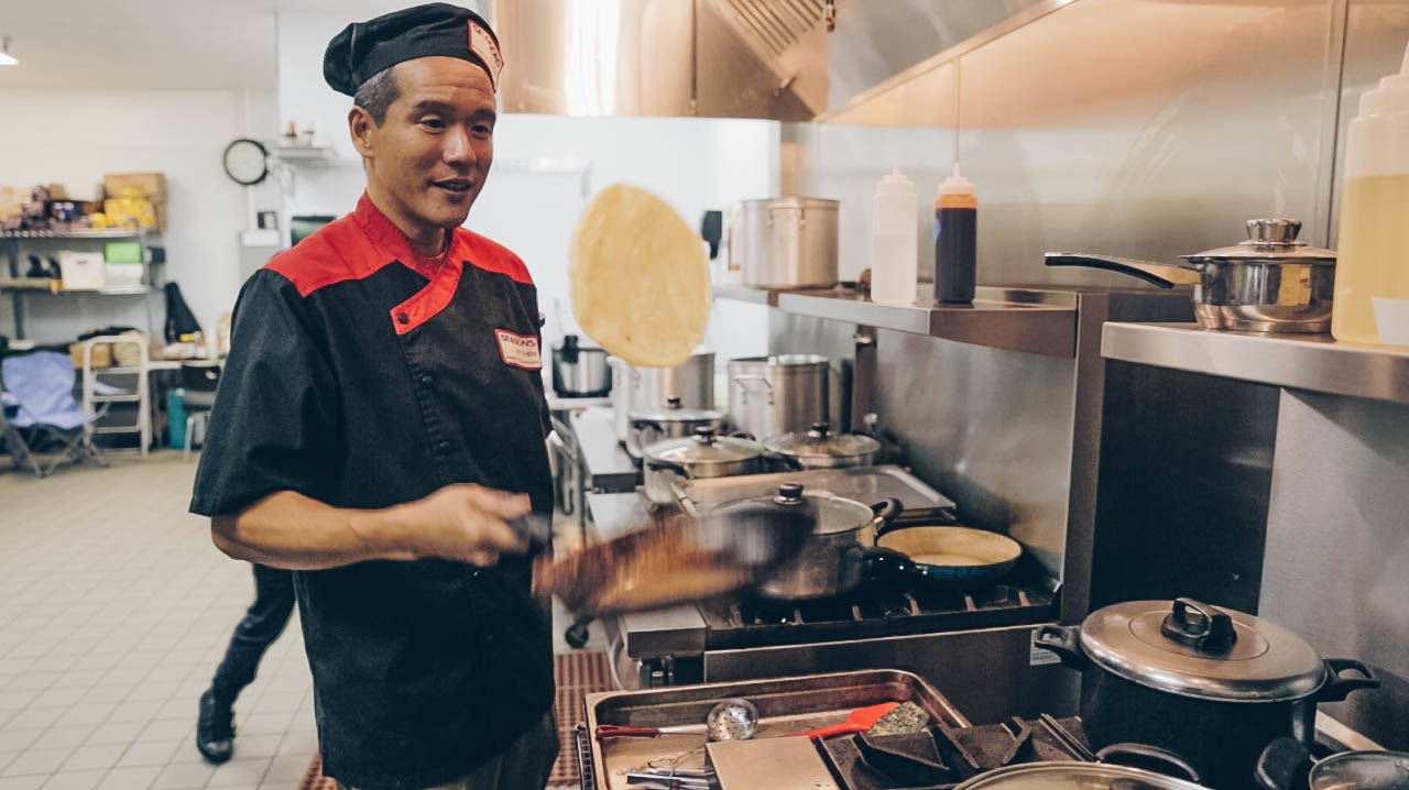 Co-founder Soon Teoh flipping roti to make sure both sides are evenly cooked.