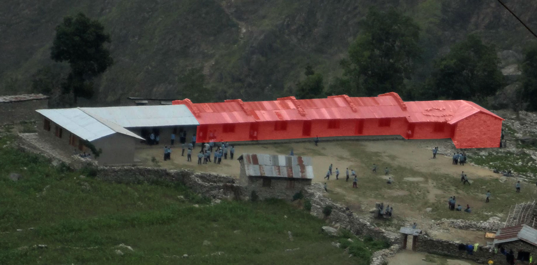 This is how the Gandagi Lower Secondary School appeared prior to the earthquake. The area highlighted in red fell to the ground forcing all 350 students to learn out of only a few rooms. Save Rural Nepal will rebuild at least four rooms starting winter 2015.