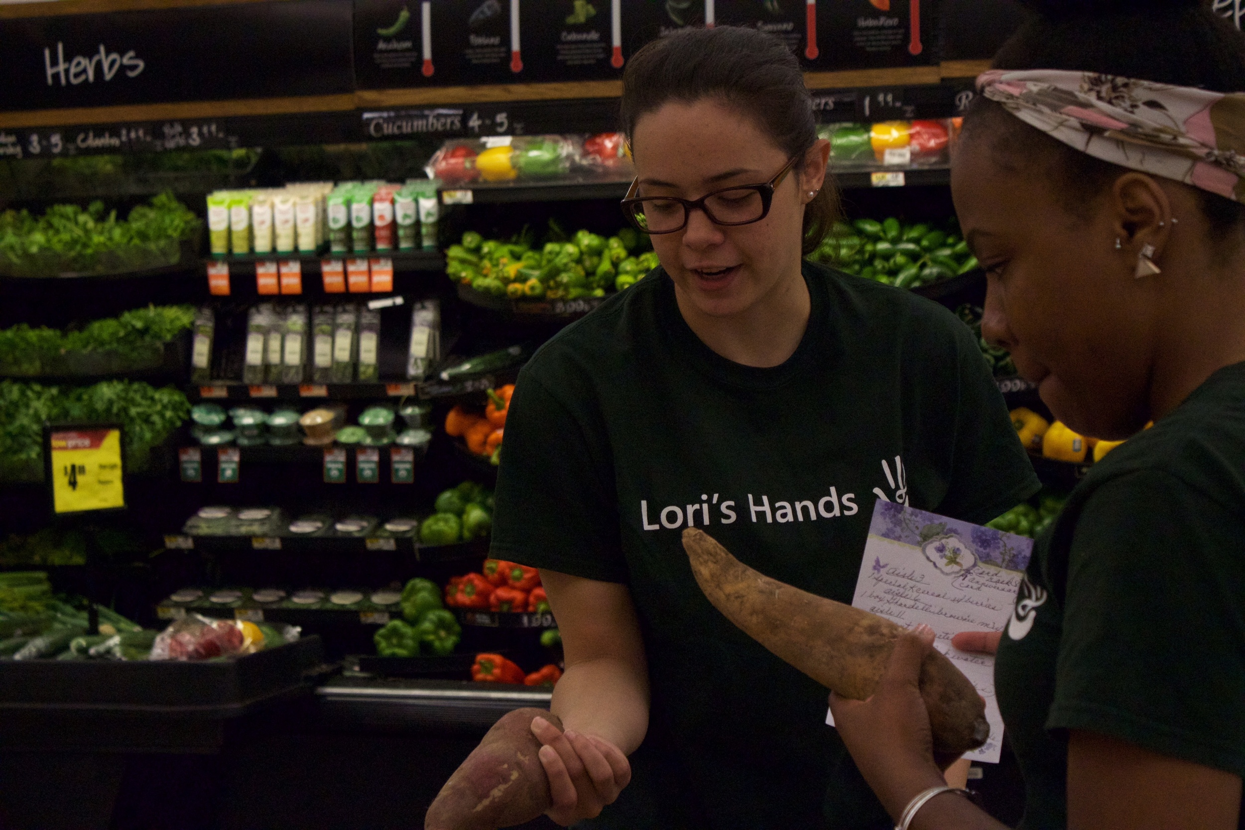 Alyssa and her student partner pick up groceries for a client