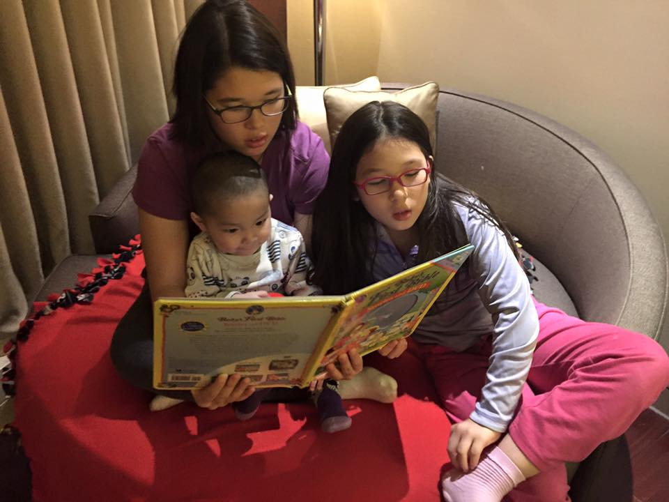 Jacob's first story time with his two big sisters, Sarah & Anna