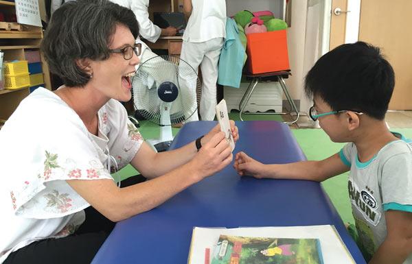 Joy Yoon (Co-Founder & International Director) teaching children with CP
