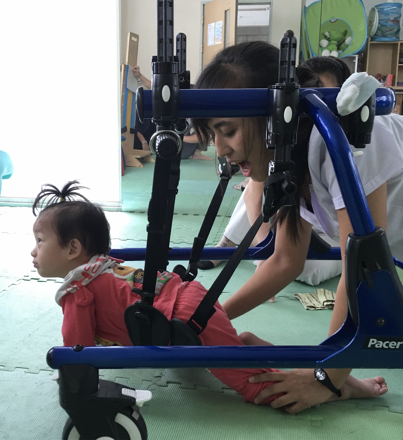 North Korean doctor helping a child with Cerebral Palsy