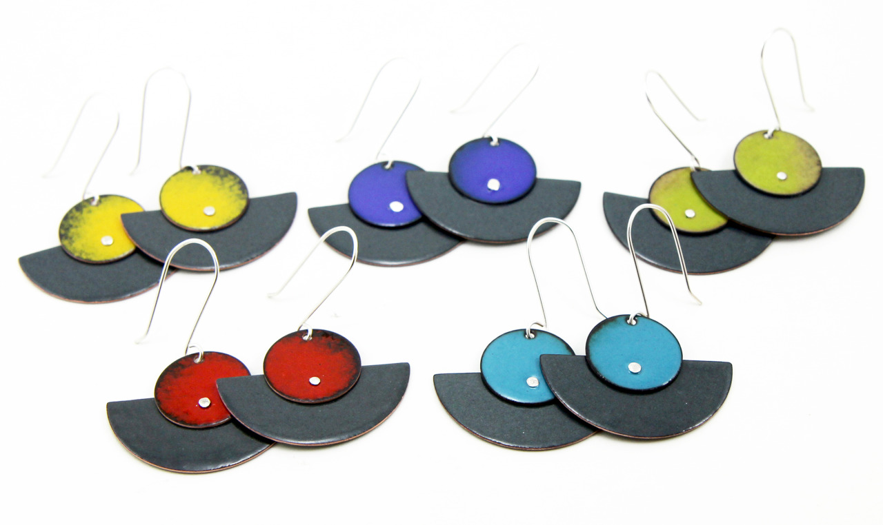 I'm happy to announce that I'll be participating in the FUSION: COLLISION / INTEGRATION show at the ACCI Gallery in Berkeley. Starting next Monday, I'll have these five pairs of fan enamel earrings on sale beside the artwork of several jewelry artists from the  Metal Arts Guild  (which I'm a member of) and  Northern California Enamel Guild .     The show is running   from October 19th - November 24th and if you stop by on Monday, November 3rd between 2pm and 6pm, I'll be at the gallery to show you them in person. Come on by and say hi!      There's also an opening night party on Friday, October 24th from 6 - 9pm that's sure to be fun. But sadly, I'll be out of town for this. I'm heading up to Walla Walla, Washington to visit my little sister - yay!        FUSION: COLLISION / INTEGRATION    WHEN:   October 19th - November 21st   Mon-Sat 11am-6pm; Sun 12pm-5pm   LOCATION:     ACCI Gallery @   1625 Shattuck Avenue, Berkeley, CA, 94709