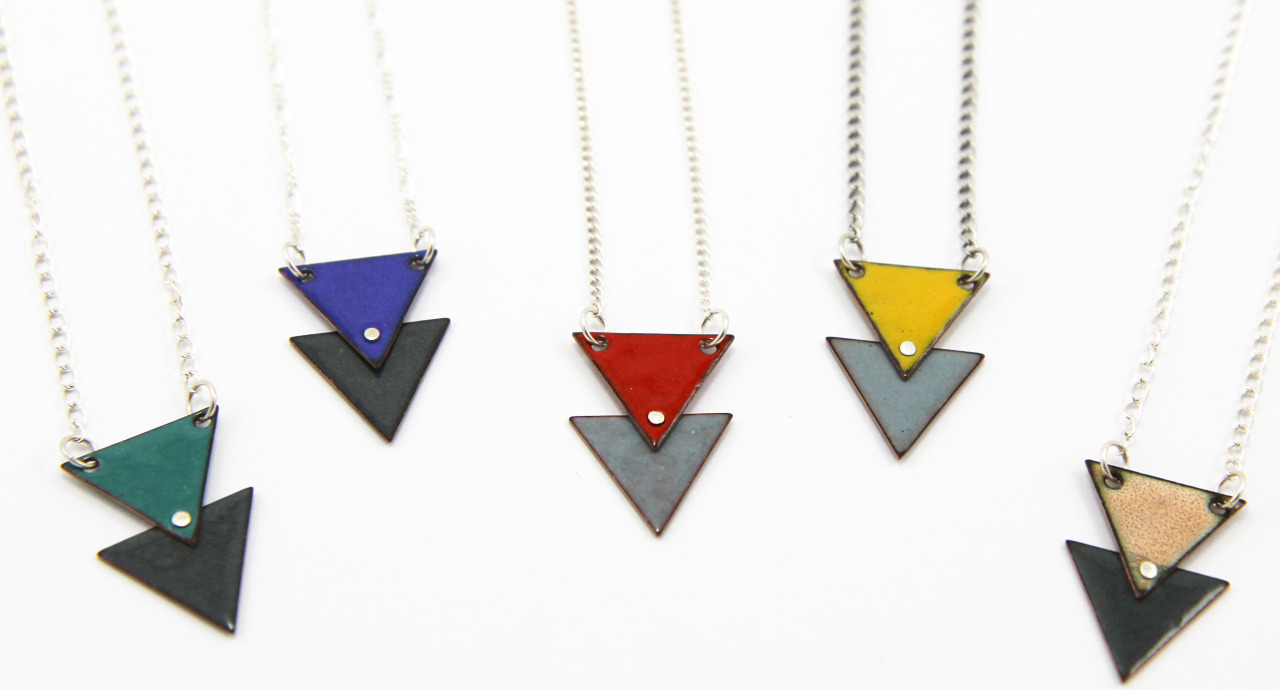 "Introducing my brand new Double Triangle Enamel Necklaces in five fun color combinations.    These lovelies start out  as two tiny copper triangles that I drill with holes, kiln-fire at 1500 degrees with colored glass enamel, rivet together with a fine silver rivet and complete with an 18"" sterling silver chain.      Check them out in my  etsy store  today."