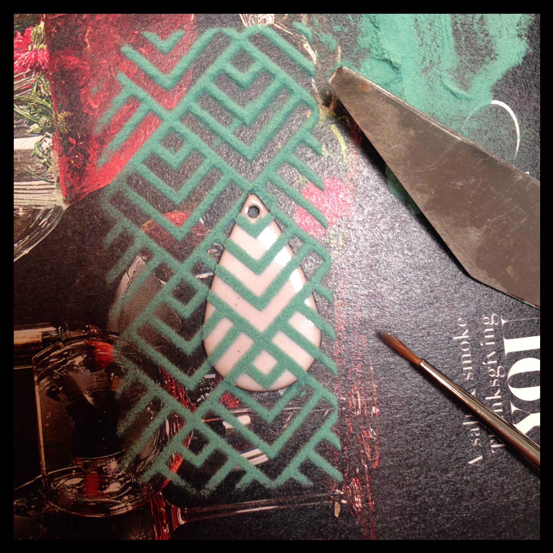 Screen printing a pattern in enamel.