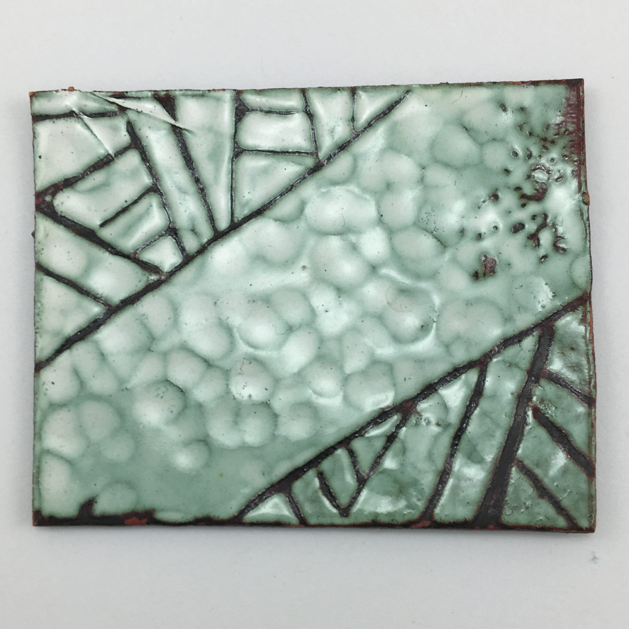 Exploring texture and sgraffito technique in white enamel.