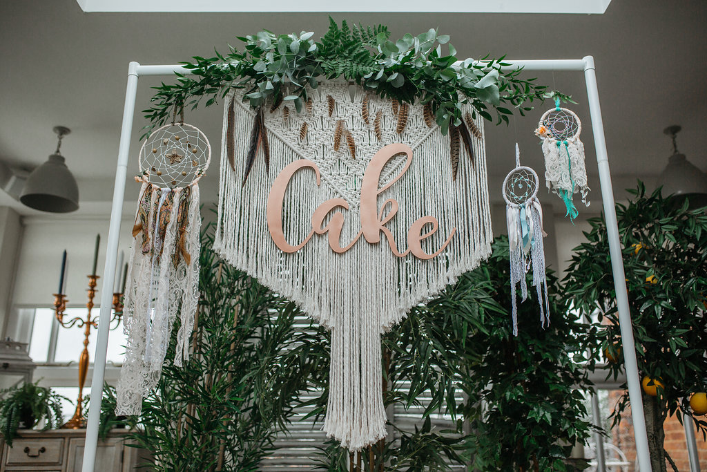 Boho botanical wedding macrame backdrop and dream catchers | The Sweet Stuff