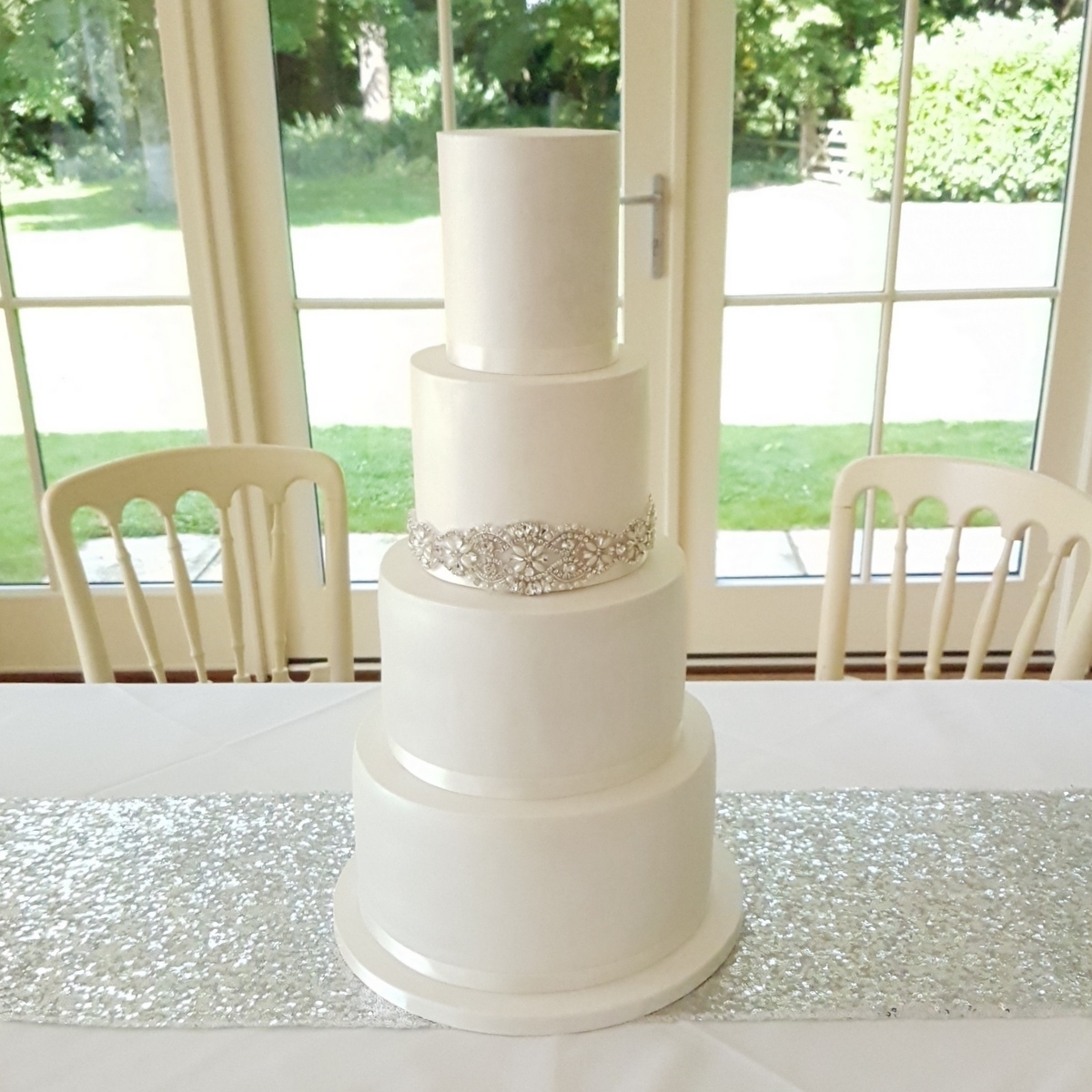 white shimmer diamante and pearl cake