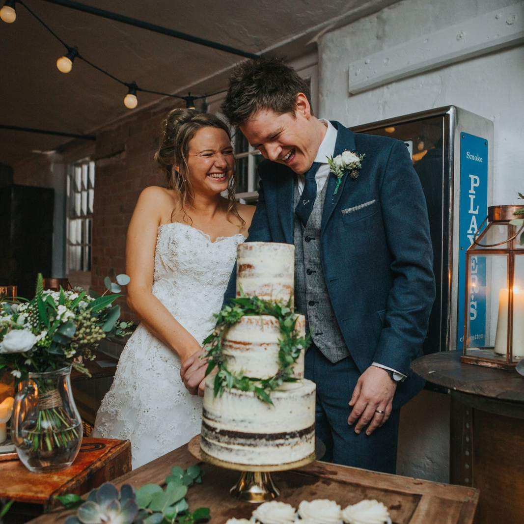 semi-naked wedding cake with garland