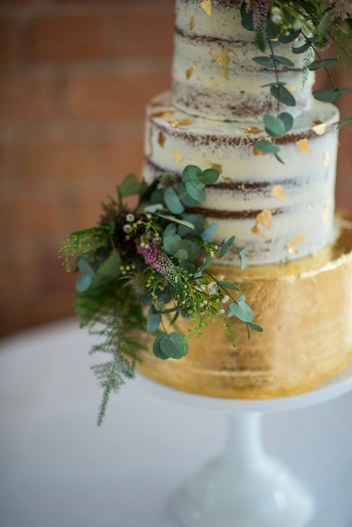 Upclose semi-naked and gold leaf cake