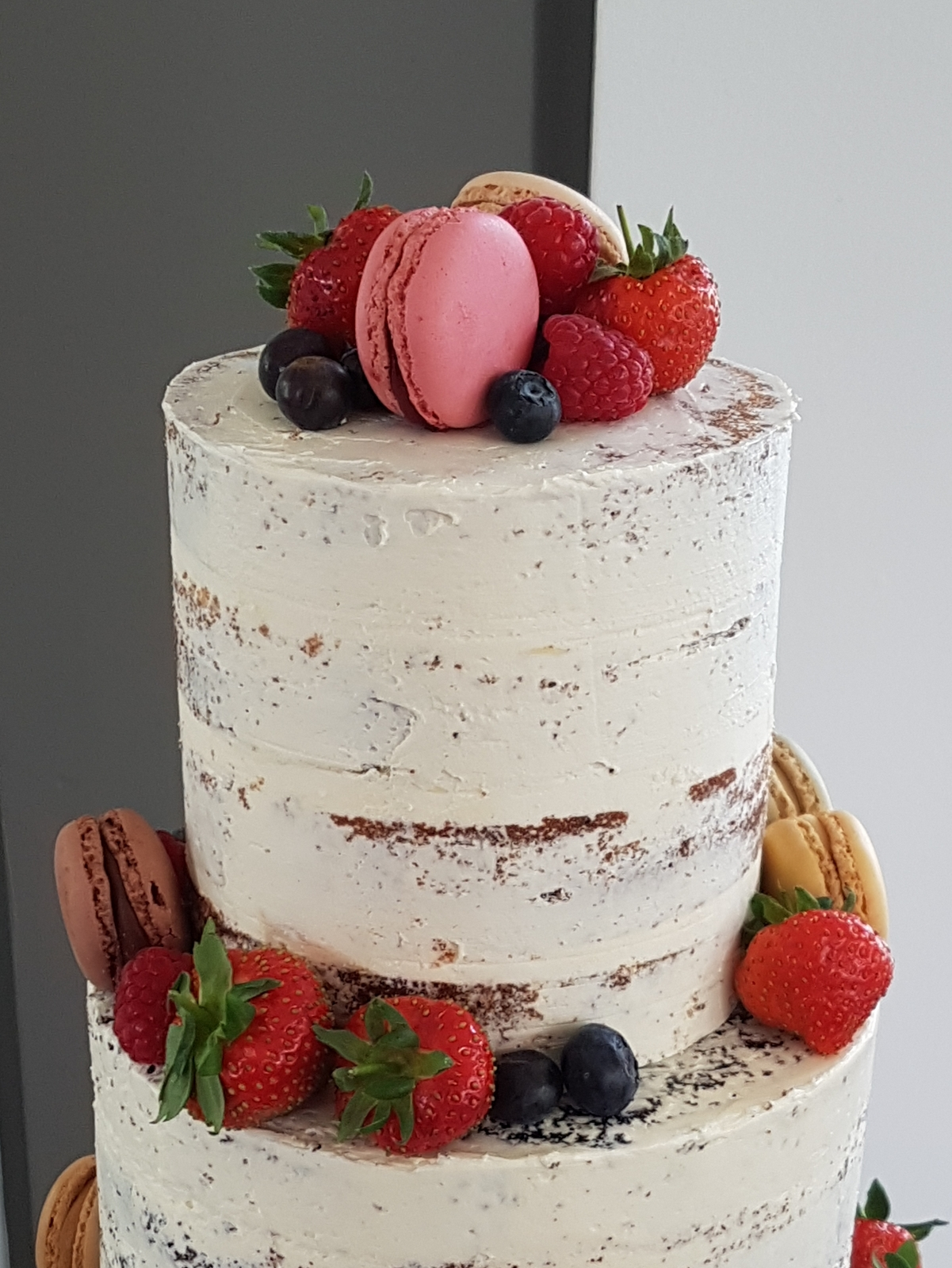 close up semi-naked macaron cake