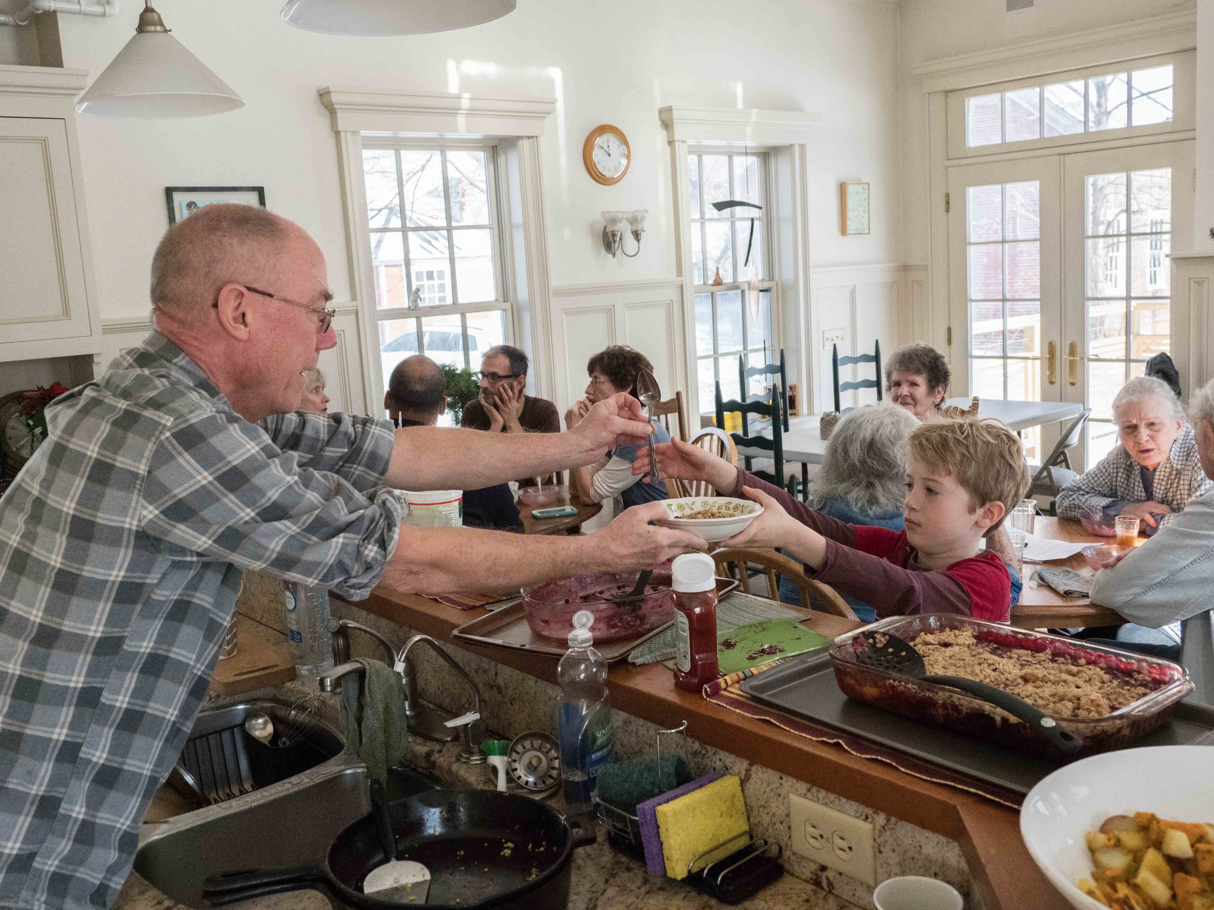Cohousing members have the opportunity to share meals prepared in the Peake House kitchen once a week or more.