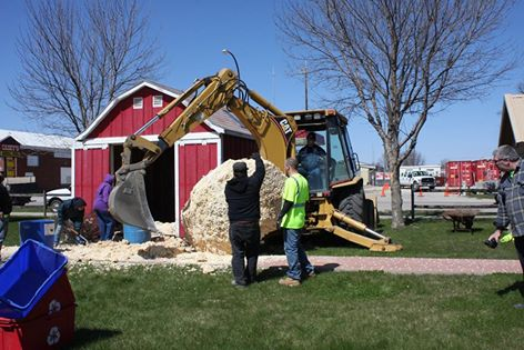Removing the 2009 popcorn ball from its home in the Museum Village. Photo courtesy of the  World's Largest Popcorn Ball on Facebook .