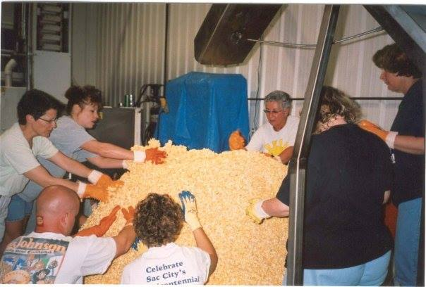 Members of the community creating the 1995 popcorn ball. Photo courtesy of the  World's Largest Popcorn Ball on Facebook .