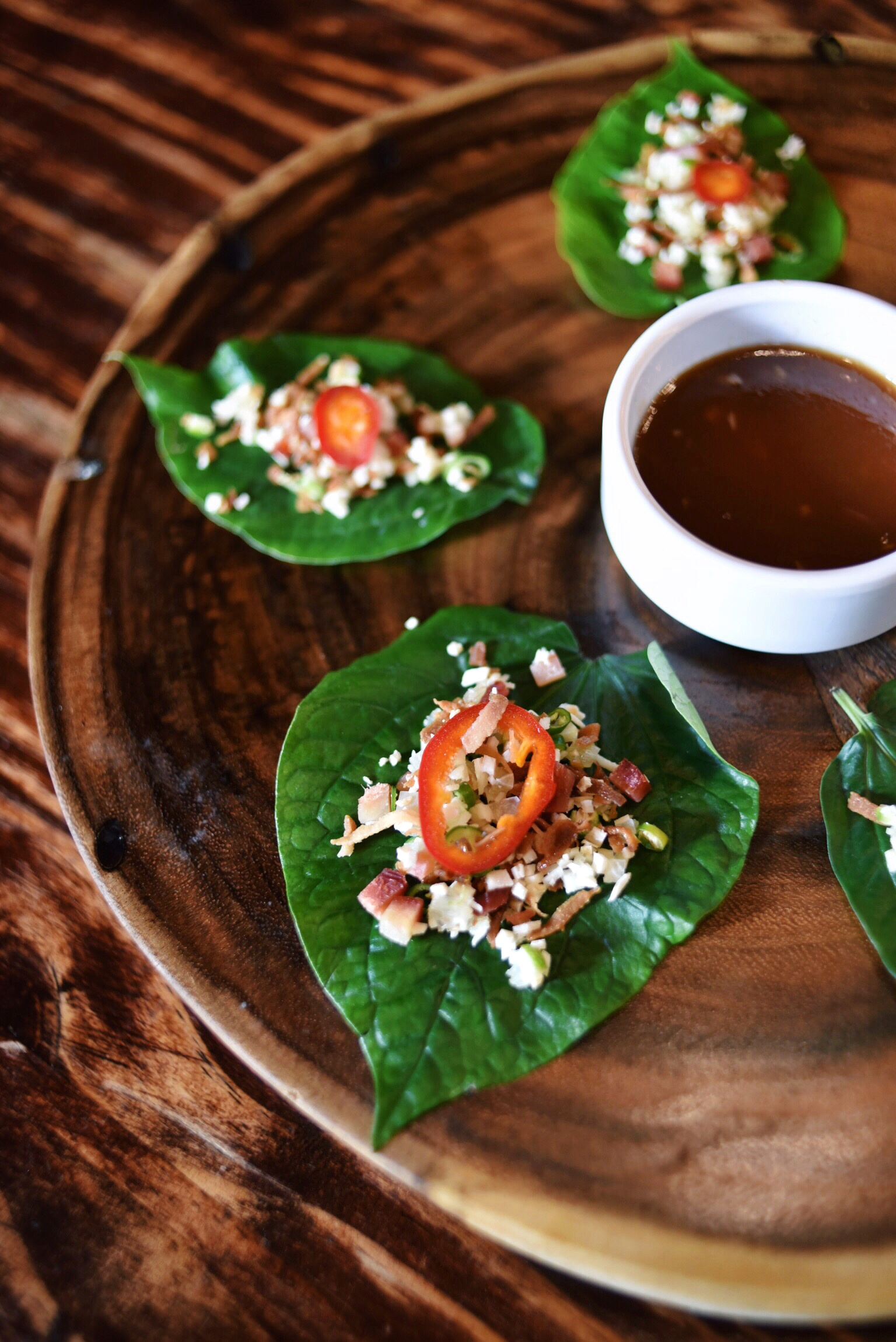 YOUNG BETEL LEAVES, CALAMANSI, COCONUT, GINGER, THAI CHILI, SMOKED MARLIN, TAMARIND