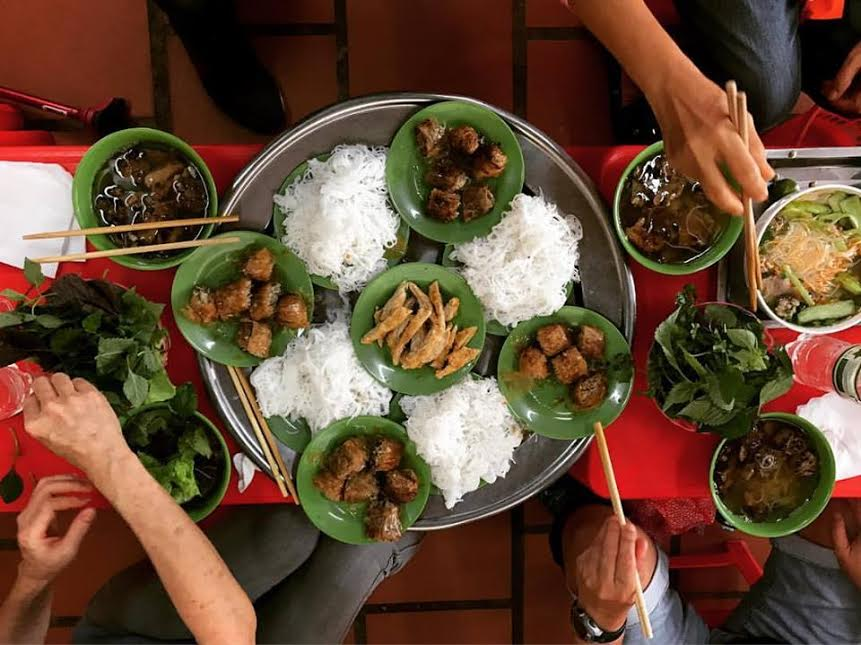 A top shot of our crew eating Bun Cha in Hanoi earlier this month.