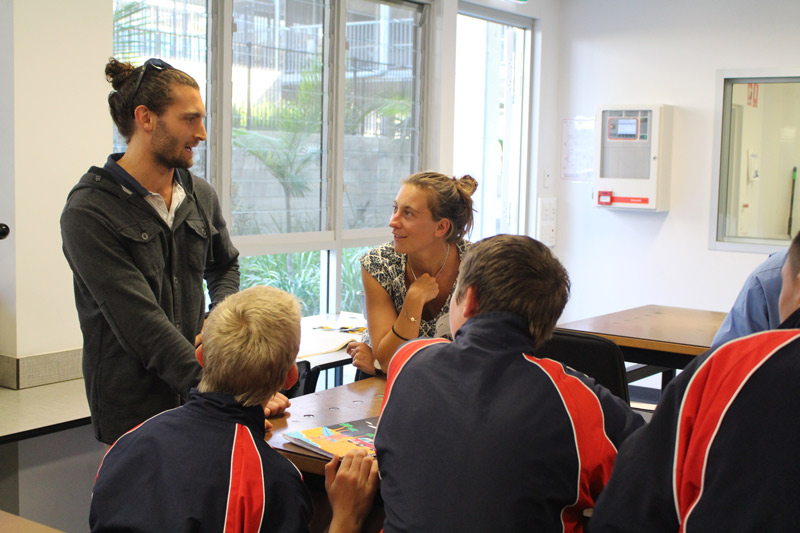 ITD teacher Dwayne Scicluna helping students break down core waste issues with FiveOceans Co-Founder Luise Grossmann.