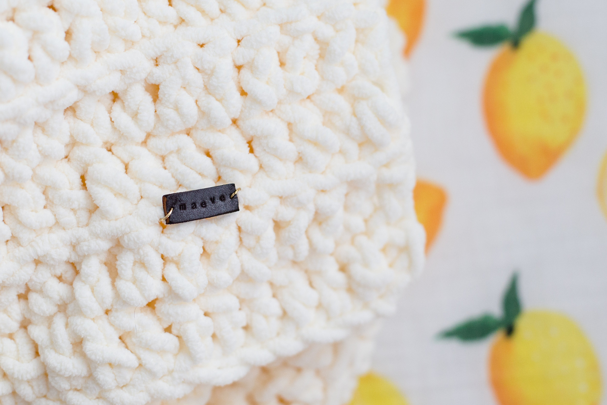 A handmade blanket with a custom, hand-stamped leather tag with her name.