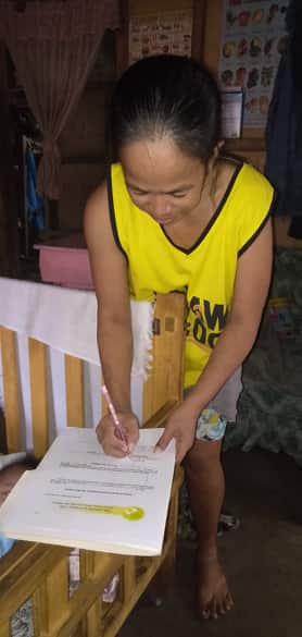 Mrs. Balilo, signing the Kasulatan.jpg