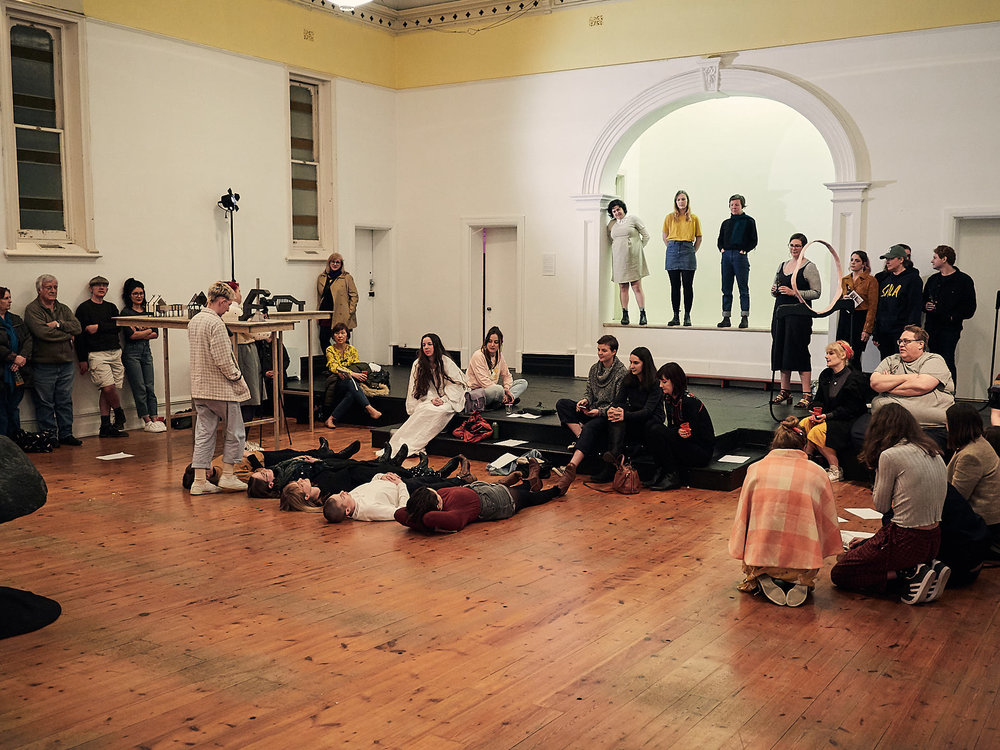 Grace Marlow, Let me carry that for you , Grace Marlow with audience participants, performed in  Psychache co- curated by Adele Sliuzas and Ray Harris, Holy Rollers, 2018. Photography by Sam Roberts.