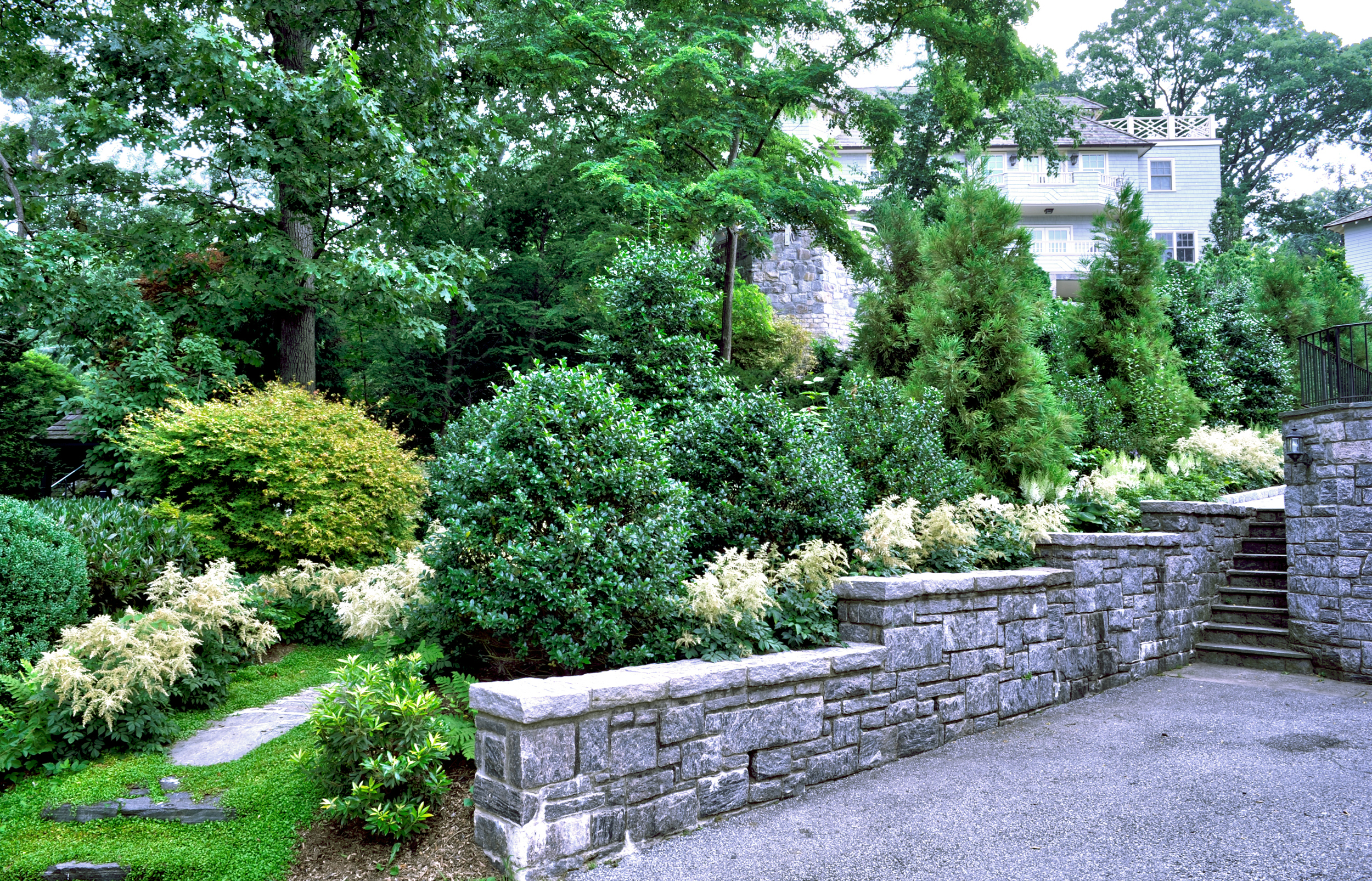 Stepped masonry garden wall with planting