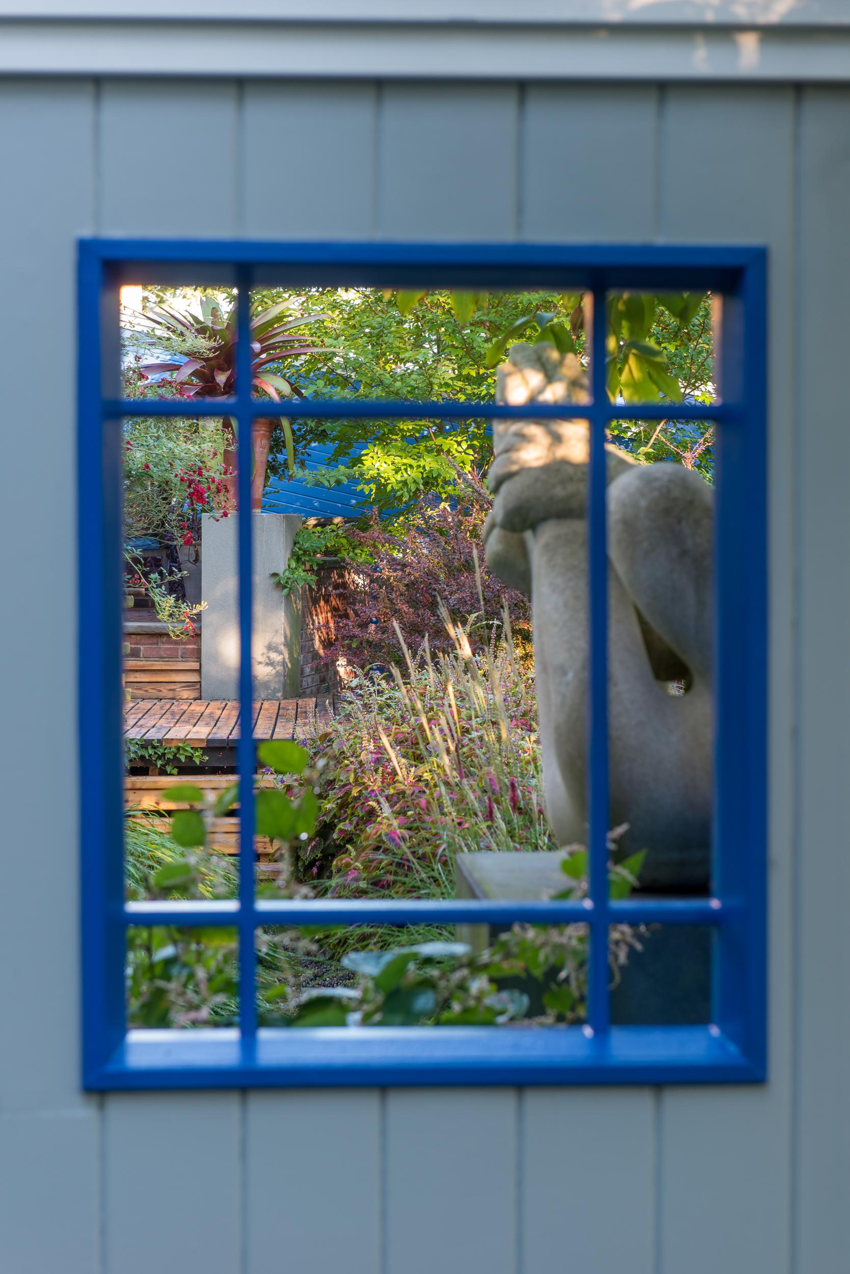 Mirror reflecting a small footprint garden