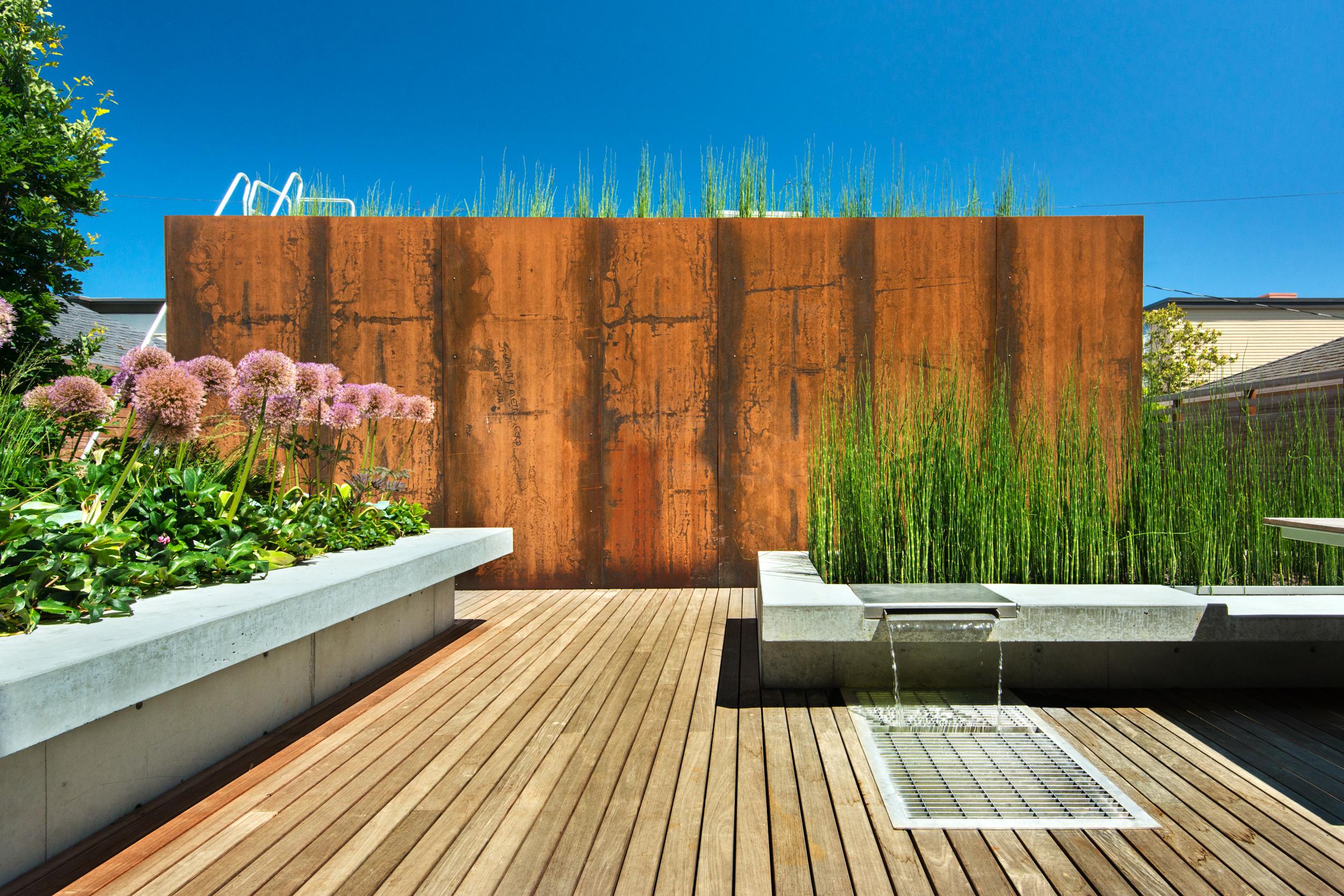 Roof top garden with raise conten steel platform and water feature