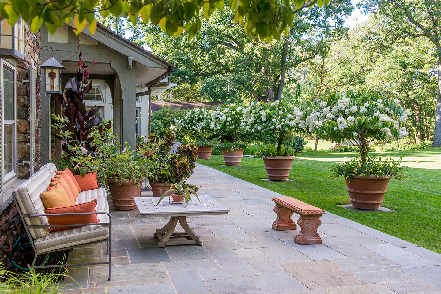 Cut stone terrace with large terracotta pots