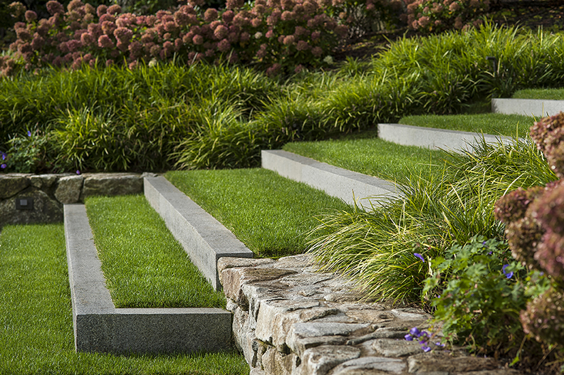 Elegant steps coincide with walls and lush plantings soften edges