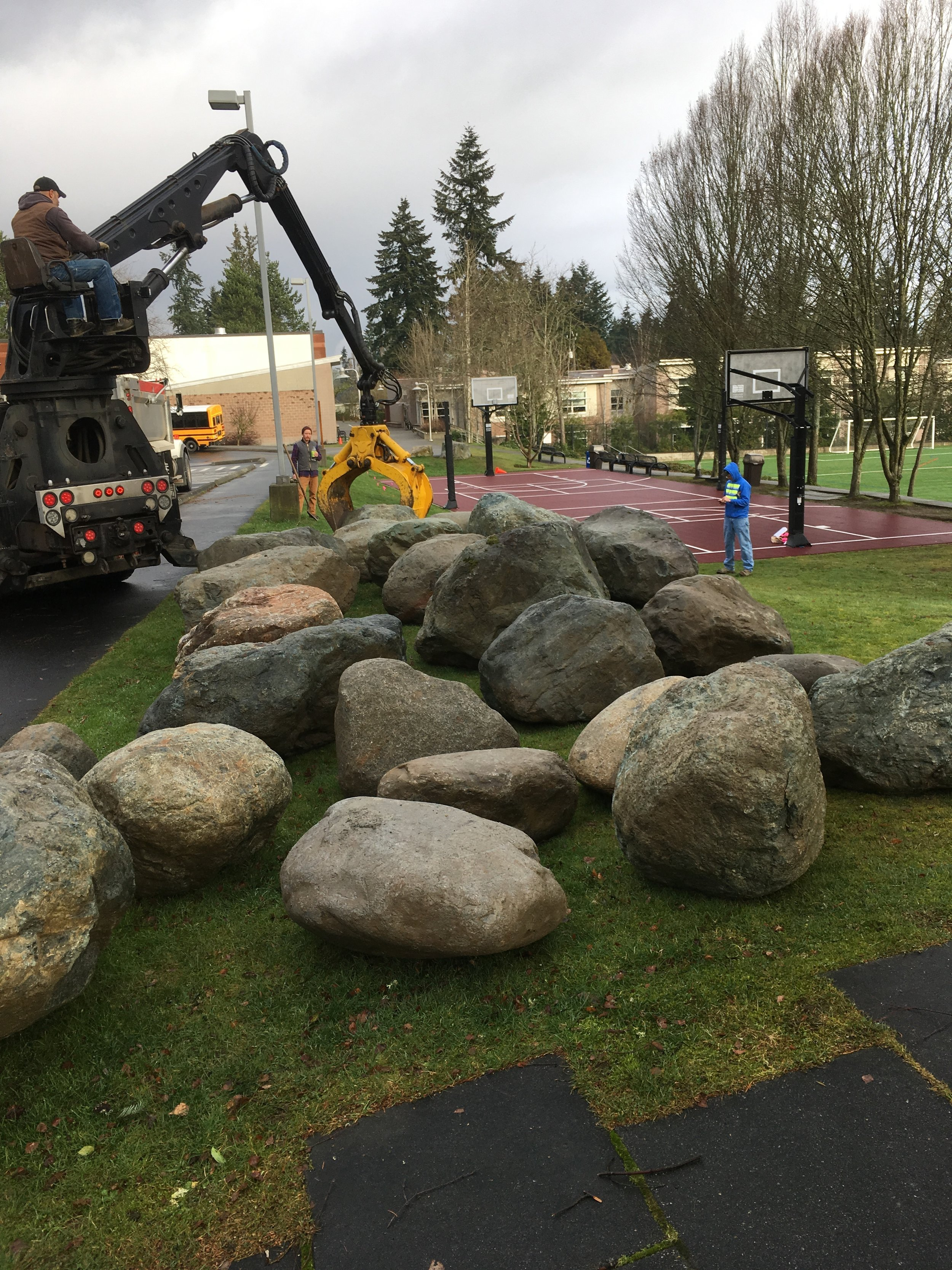 A field of hand-selected glacial erratic boulders await layout!