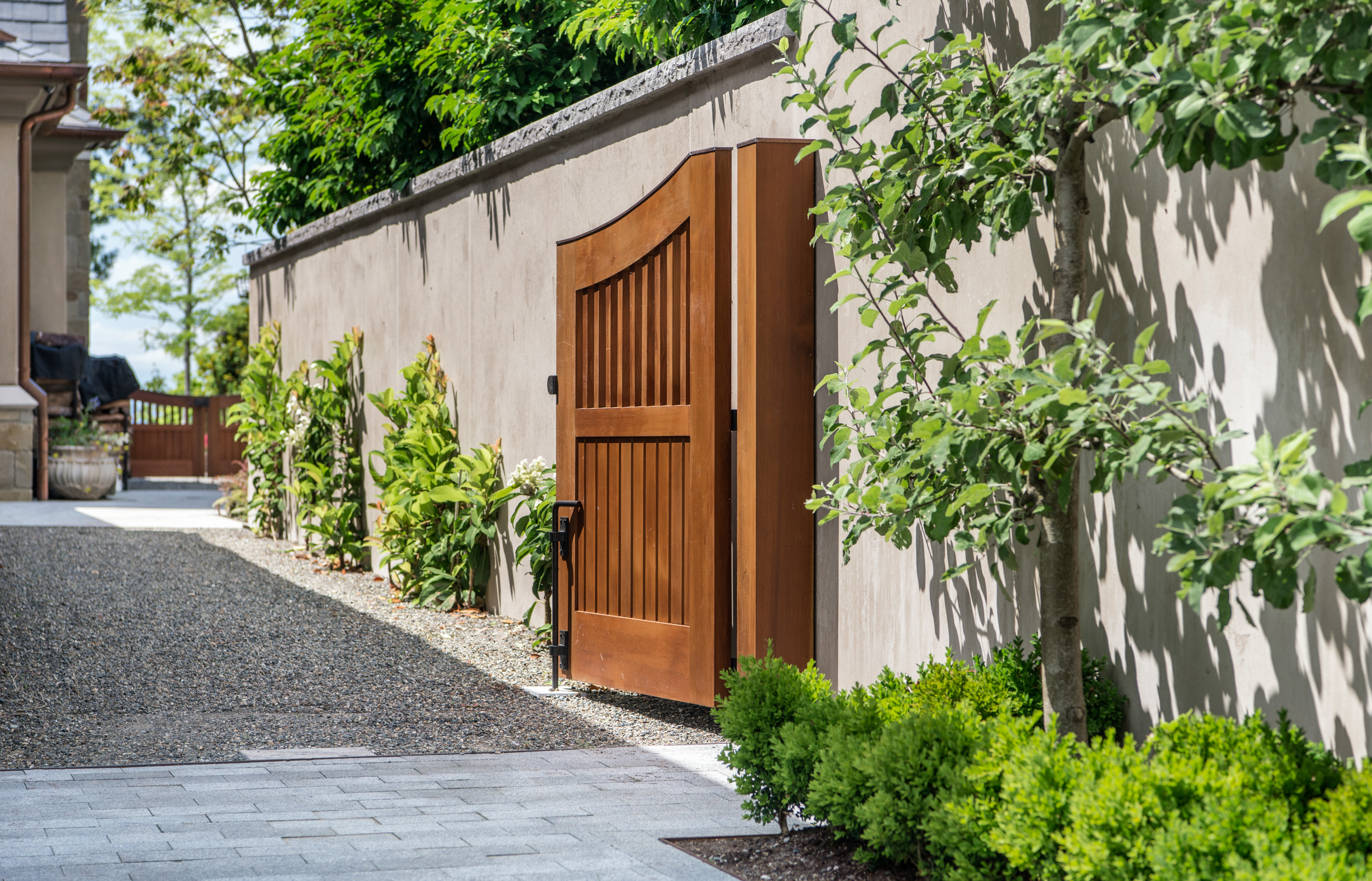 Entranceway with wooden gate and espaliered fruit tree  Photo by Miranda Estes Photography