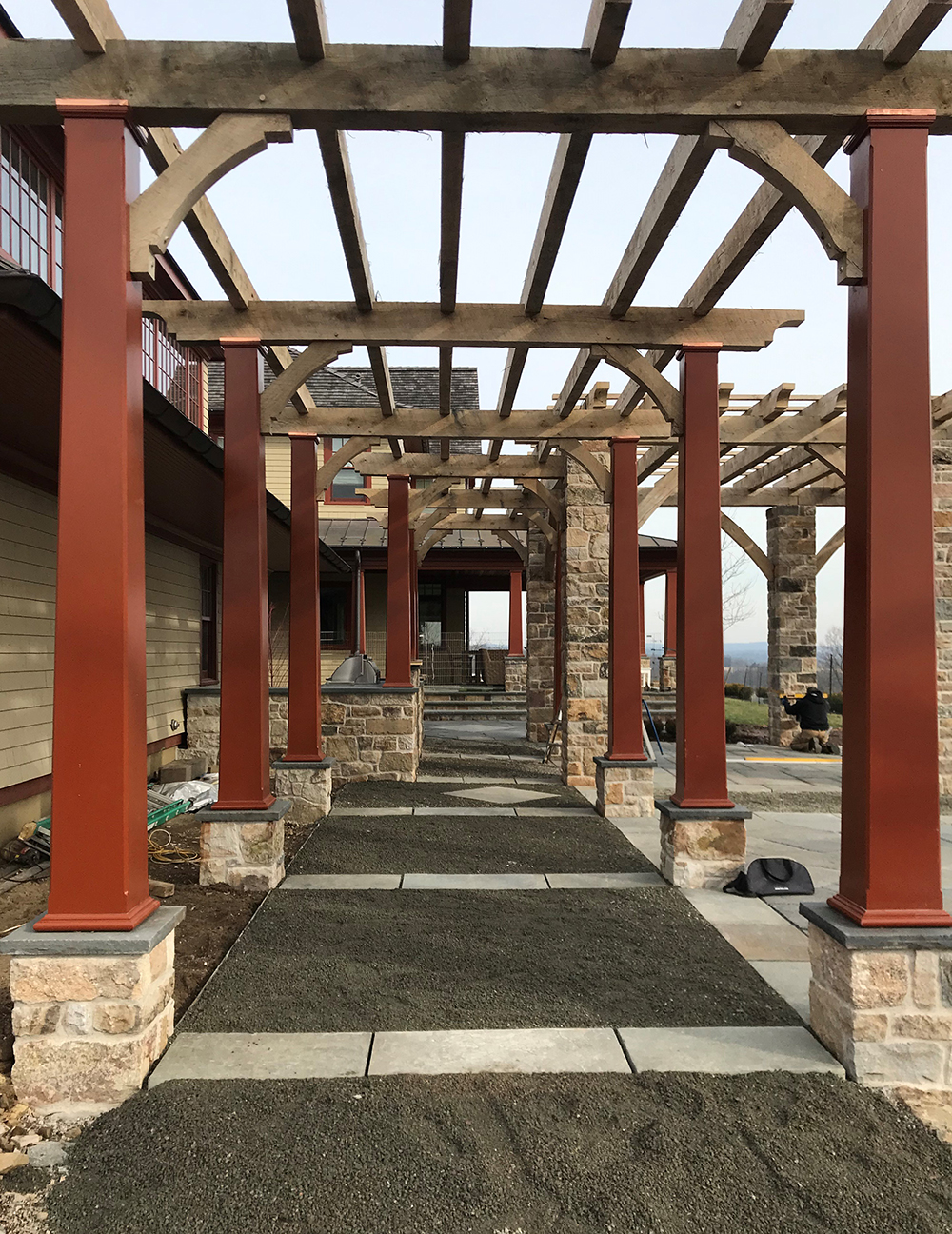 The pergola with existing porch in the background