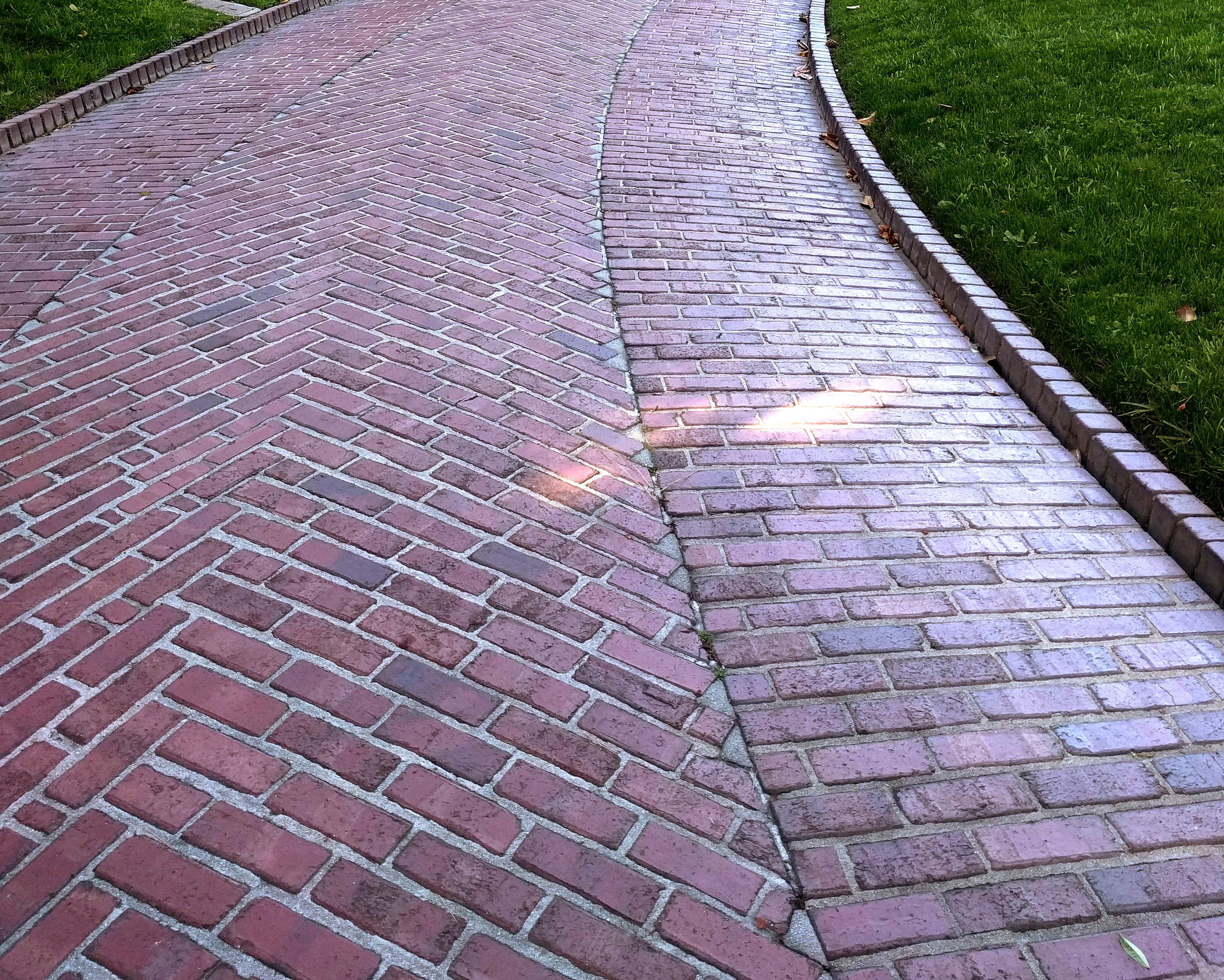 Multiple patterns and an integrated curb feature in this historic driveway at the  Gamble House  in California.