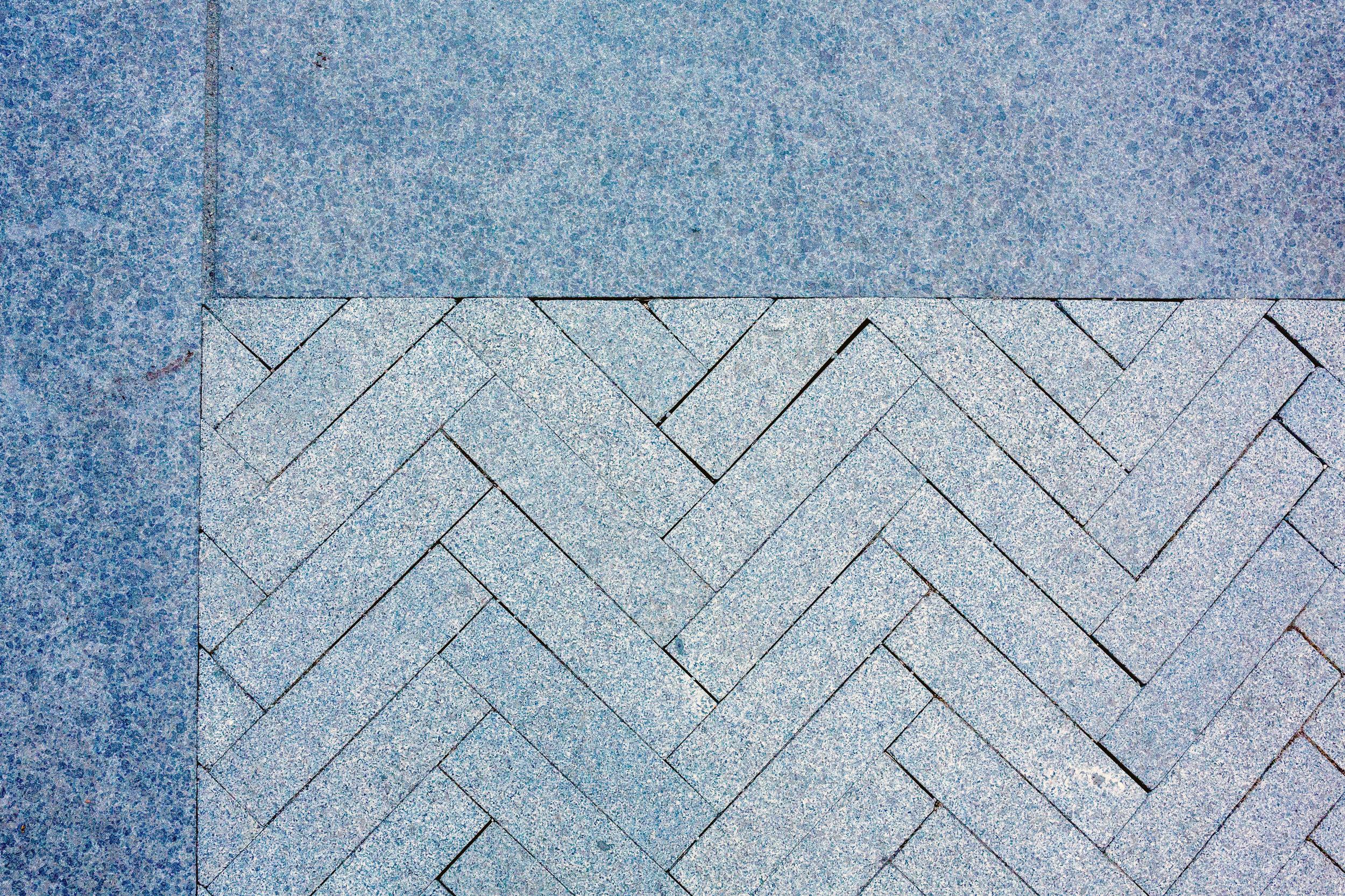 A sand-set herringbone pattern with a stone border.