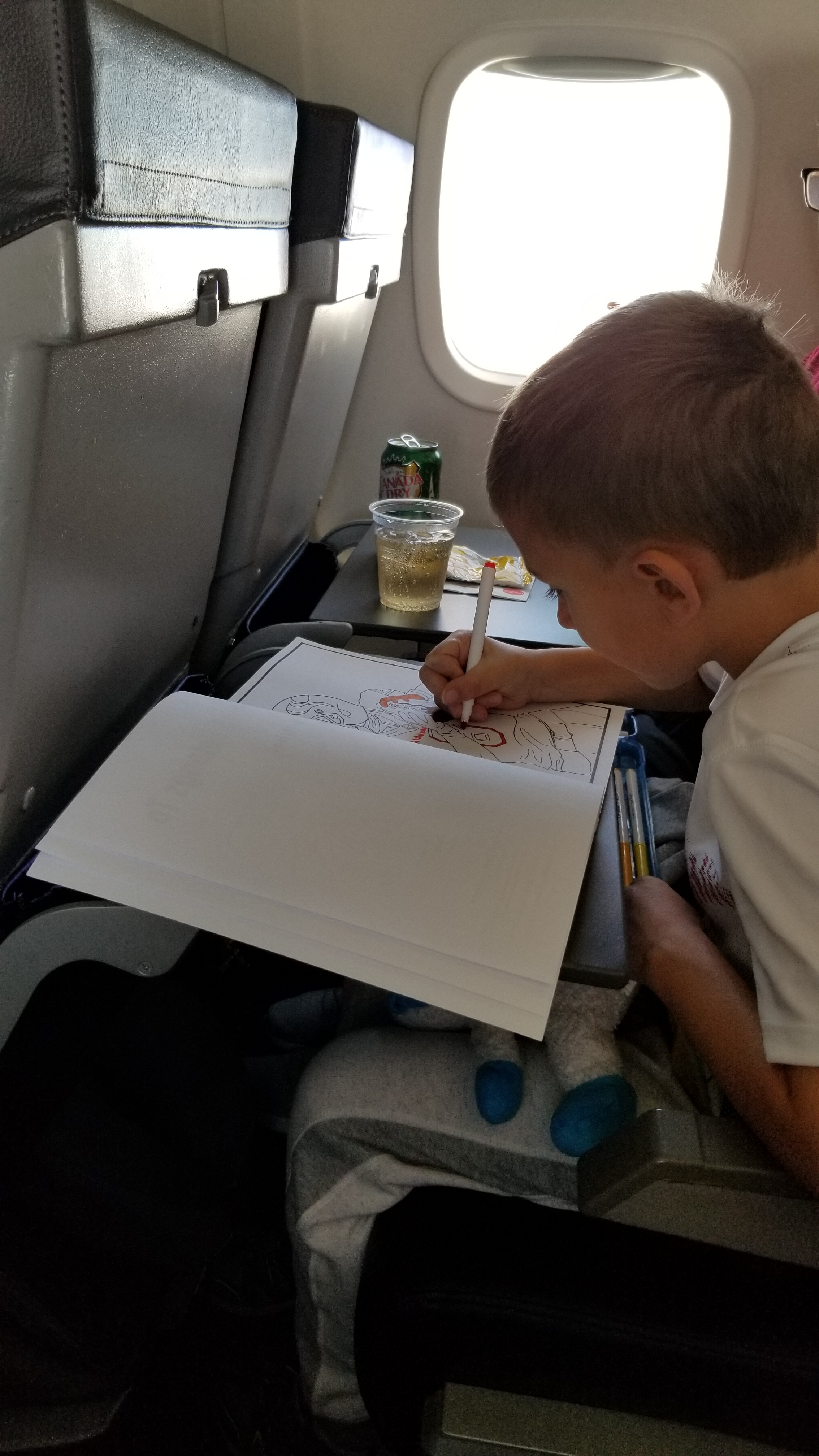 Caleb passing time on the flights