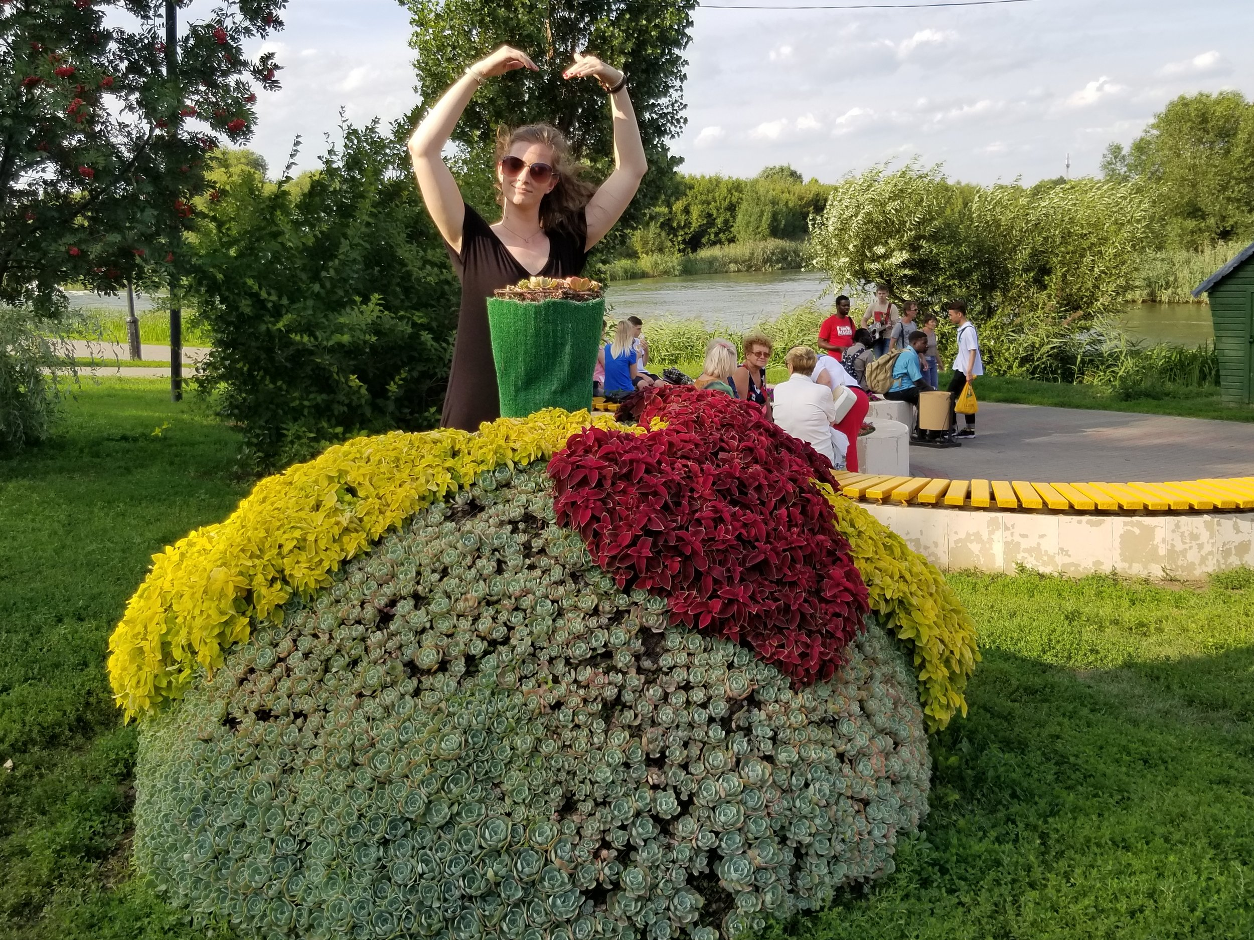 Deborah demonstrating how to pose for the famous flower ball gown by the river in Tambov