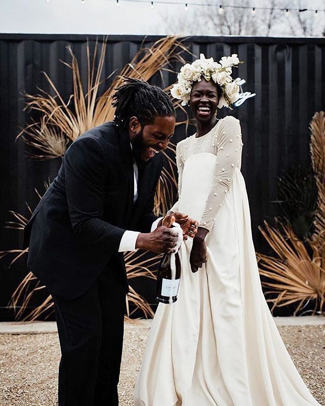 🍾 Happy Friday y'all! You may just find us recreating this moment this weekend... minus the dress, tux and flower crown (🙆🏽‍♀️). // 📷: @freckledfoxphotography • #friyay #blackbride #flowercrown #munaluchibride #weddingsonpoint #blackbride1998 #bridalinspo #aisleperfect #flowerheadband #proudtobe #weddingidea #weddingstyle #nycwedding #bridalstyle