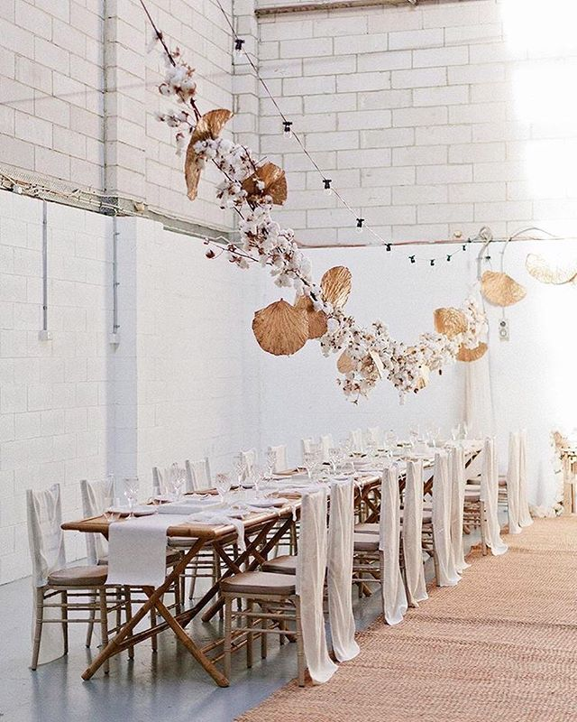 One word: TRANSFORMED. 🐣 Touches of natural tones, fabrics, and textures transformed this concrete warehouse into something spectacular. 👏🏽 Amazing job @styled_by_her • Photography @kyliemillsphotography  Styling @styled_by_her  Venue @fauxflowercompany  Florals @poppiesandamber