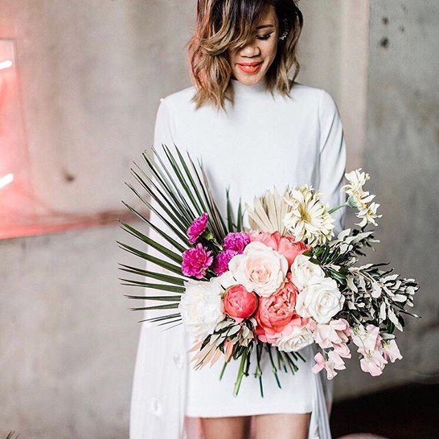 "Reminding ourselves that no ☔ = no 💐. Also, we saw this bouquet and we're officially ""nontraditional"", thanks. Consider this our bio update ✨. 