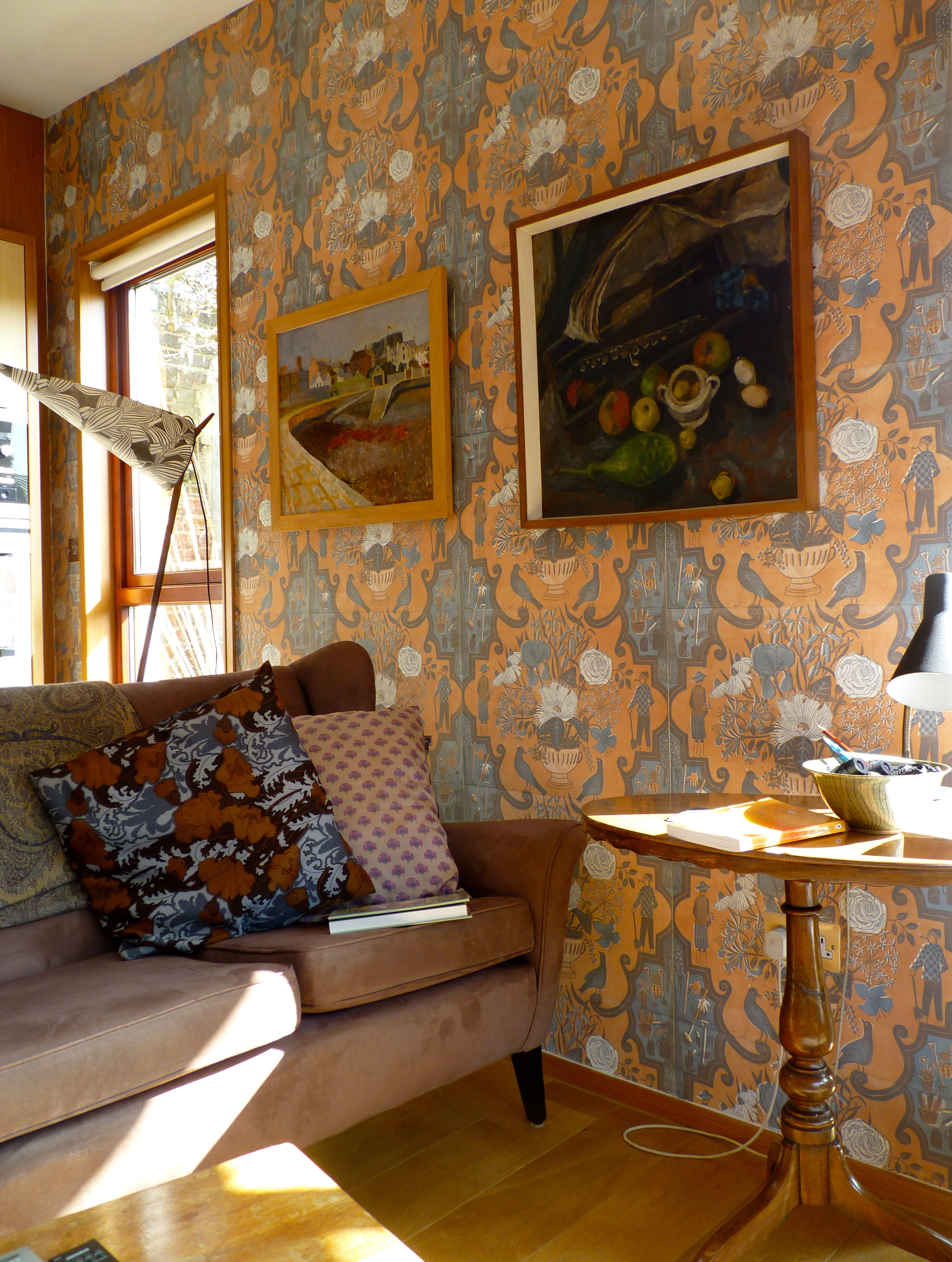 """Gardeners"" installed in Marthe's sitting room, along with a lamp designed by her late husband, featuring ""Solomon's Seal"" on the shade. A  new version of this lamp  is being produced by her grandson Joe. Both photos of Marthe's home from  Bible of British Taste ."