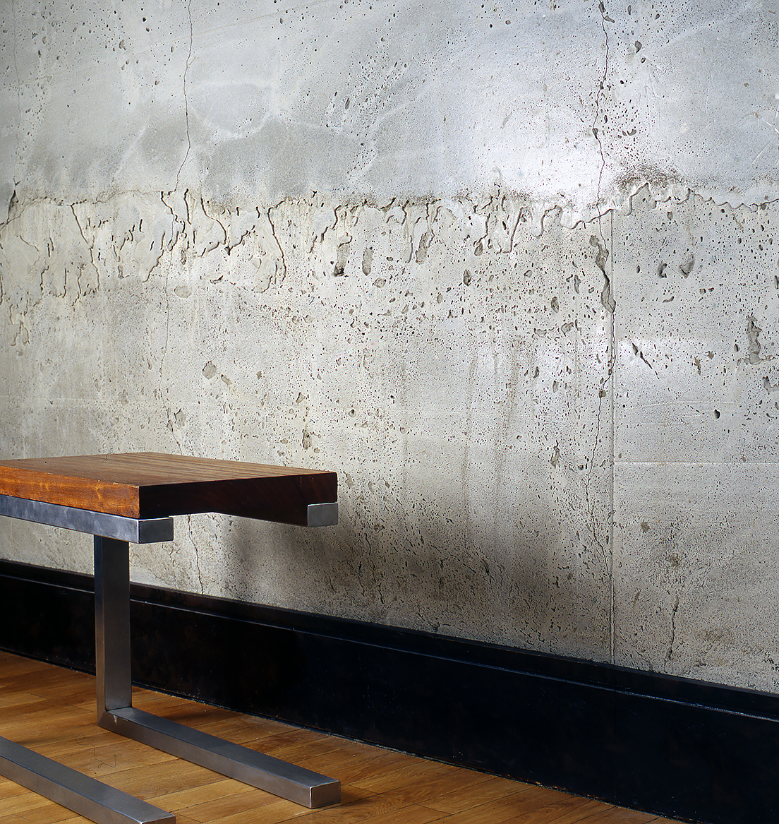 Chair: Eroko and Stainless Steel: Polished Concrete Wall