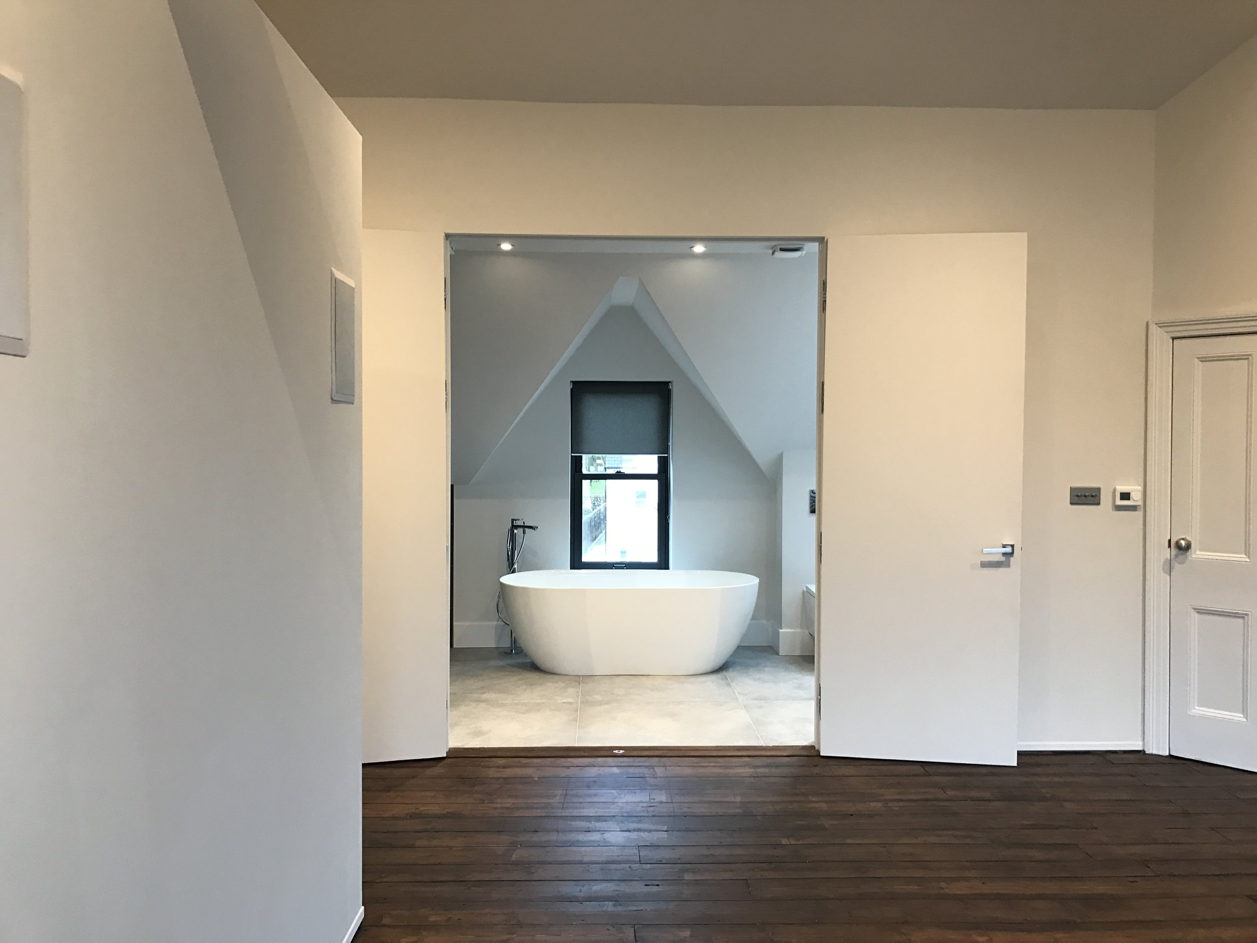 The loft space has been completely opened up to form the Master Bedroom, with 180 degree opening full height blank doors, into the En-suite Bathroom / Steam Room.