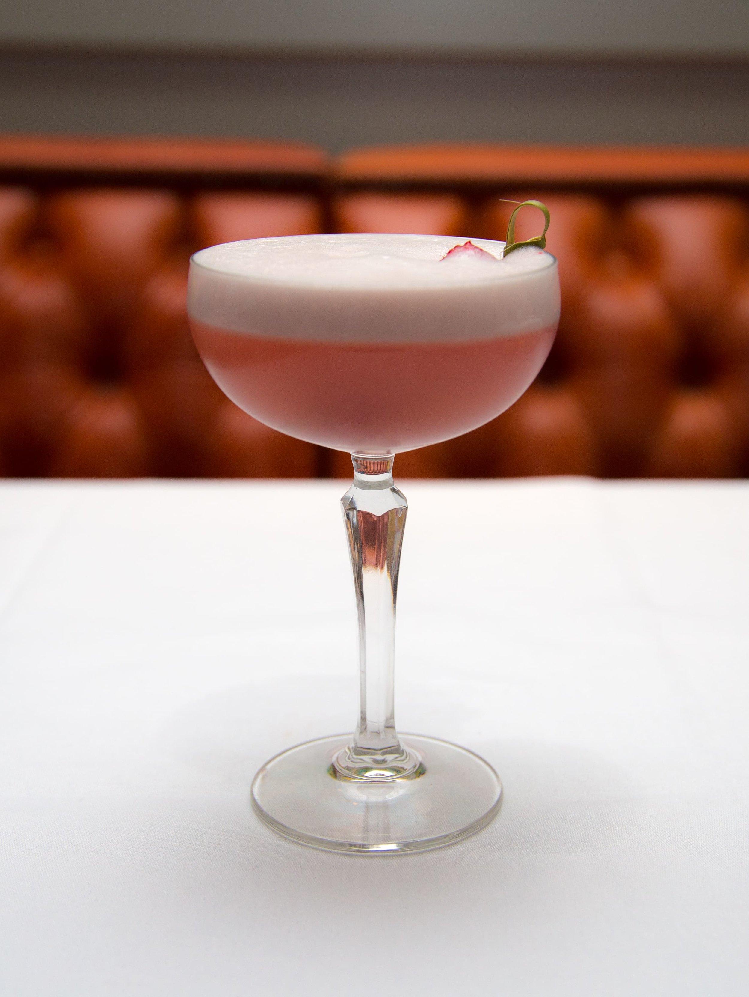 Clover Queen cocktail – Boadicea Rosa gin, lemon juice, raspberry syrup, egg white – garnish with raspberries
