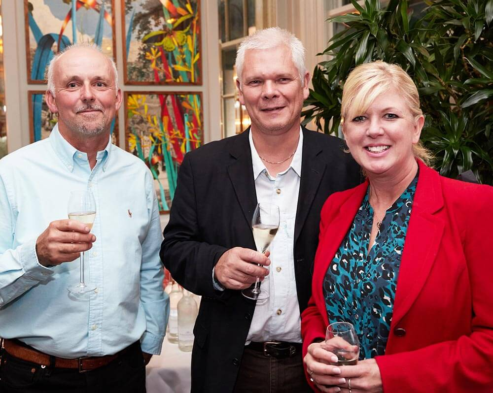 Mark Templeman of Norwich Rotary with Matt and Steph Brown of Wild Knight Distillery