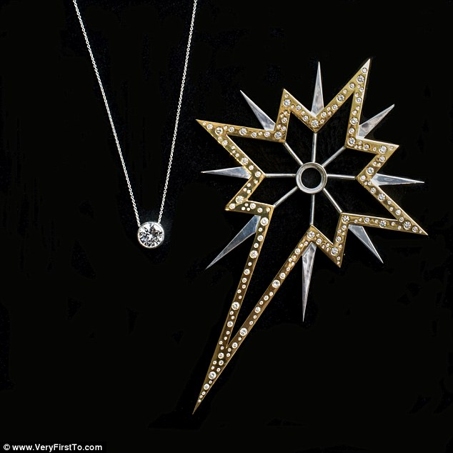 2F5ECDBD00000578-3359559-The_tree_topper_is_handmade_from_solid_silver_gold_plated_and_co-a-21_1450115858488.jpg