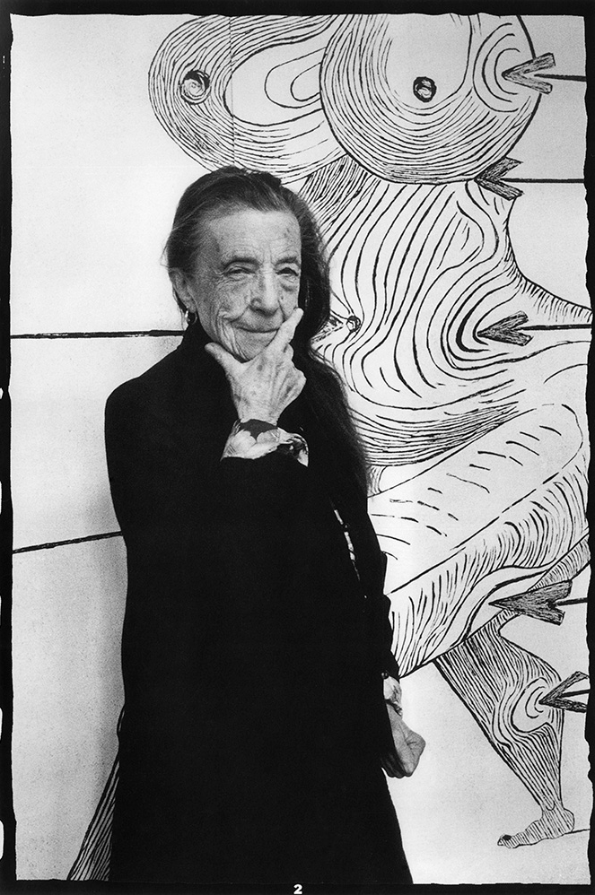 Louise Bourgeois in front of  Saint Sebastienne  in her Brooklyn studio (1993). Photo: © Vera Isler, © The Easton Foundation/VAGA, NY
