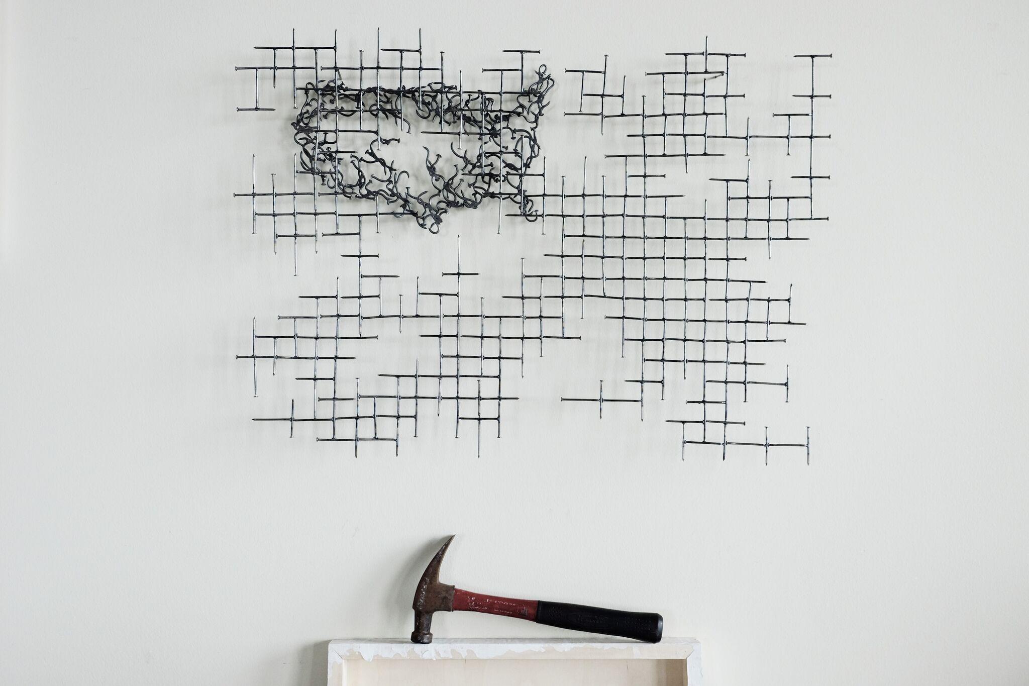 USA behind tattered grid hammer.jpg