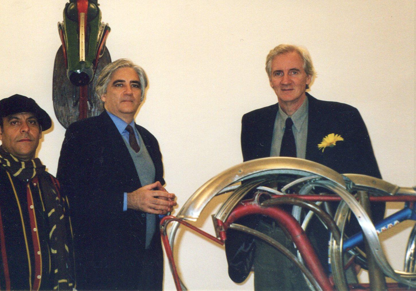 """Right to Left, Leonard Streckfus, curator Luigi Sansone and artist Salvatore Cuschera at the opening of """"Leonard Streckfus: l'artista del' gran rifiuto,"""" Galleria Solaria Arte, Piacenza, Italy, 2002."""
