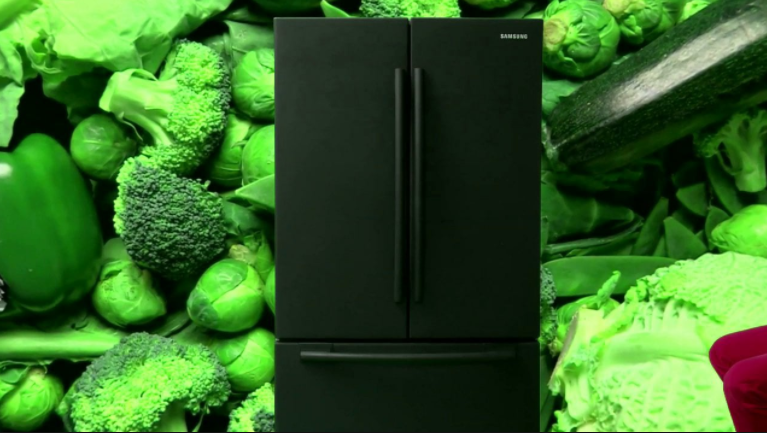 Mark Leckey, GreenScreenRefrigeratorAction, Samsung refrigerator, rear screen projection rig, digital video, green screen set, PA, can of coolant (2010)