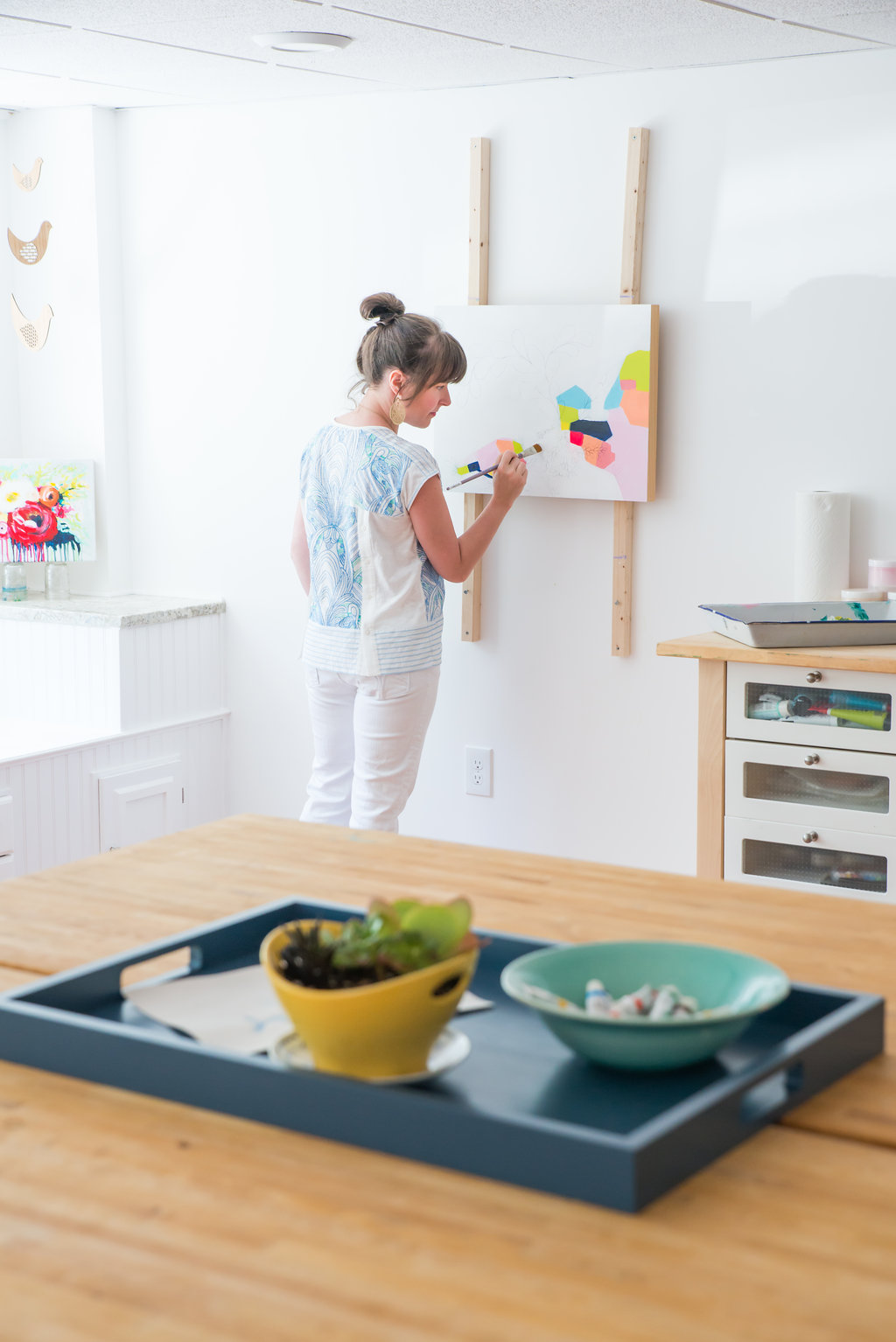 Megan Carty painting in her studio